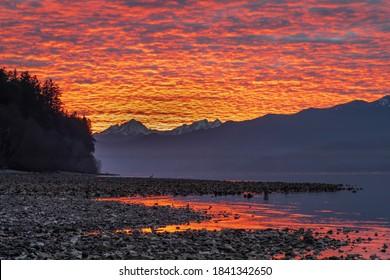 USA, Washington State, Seabeck. Sunset on Hood Canal and Olympic Mountains.