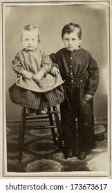 USA - WISCONSIN - CIRCA 1865 - A vintage Cartes de visite photo of a little boy and baby girl. The boy is standing and the baby is sitting. A photo from the Civil War Victorian era. CIRCA 1865
