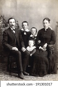USA - WISCONSIN - CIRCA 1885 A vintage photo of a Victorian family. The parents are sitting with three small children. The father has a mustache. This photo is from the Victorian era. CIRCA 1885