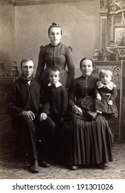 USA - WISCONSIN - CIRCA 1885 A vintage photo of a Victorian family. The parents are sitting with three children. The father has a beard. This photo is from the Victorian era. CIRCA 1885