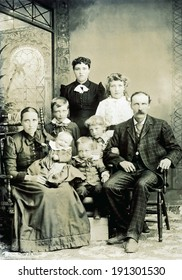 USA - WISCONSIN - CIRCA 1890 A vintage photo of a large Victorian family. The parents are sitting with six children. The mother is holding a smiling baby. Photo is from the Victorian era. CIRCA 1890