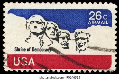 USA-CIRCA 1974: A stamp printed in USA shows stone sculptures of George Washington, Thomas Jefferson, Theodore Roosevelt, and Abraham Lincoln, circa 1974