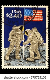 USA-CIRCA 2016 A stamp printed in the United States shows Men Raising the Flag on the Moon , circa 2016.