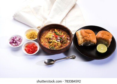 Usal/Misal Pav is a traditional Chat food from Maharashtra, India. Served over moody background. Selective focus