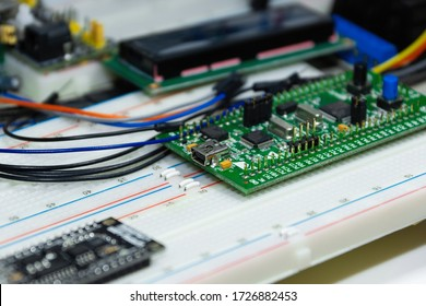 Usb 2.0 type mini b  of the stm like debugging board on the breadboards with wires and lcd display on the background.