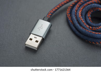 USB cable with cable against a dark background..
