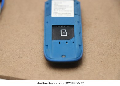 usb dongle with sim card icon in wood background. wifi dongle with visible sim card port