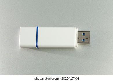 USB Dongle Stick Flash Drive closeup on aluminum background