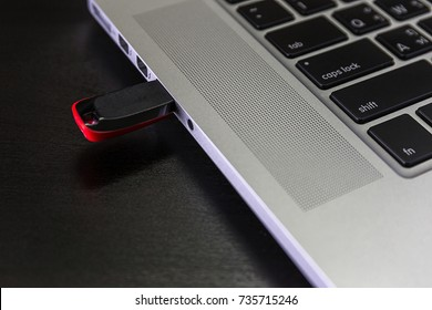 USB flash cards and thumb drive or stick Virtual memory storage with USB cable into slot  laptop computer