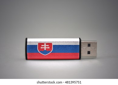usb flash drive with the national flag of slovakia on gray background. concept