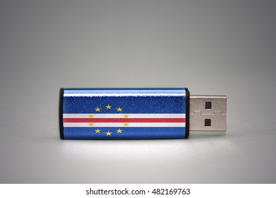 usb flash drive with the national flag of cape verde on gray background. concept
