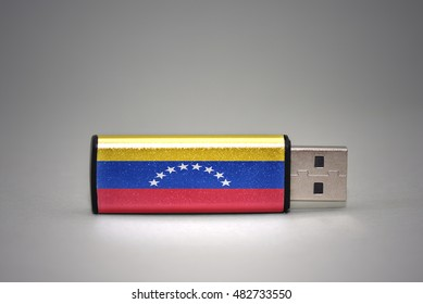 usb flash drive with the national flag of venezuela on gray background. concept