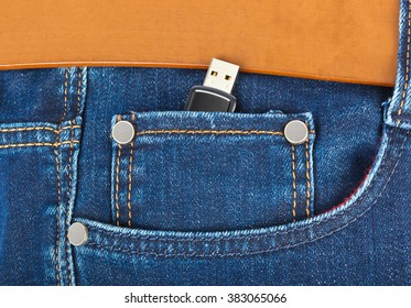 USB flash memory in jeans pocket - technology background