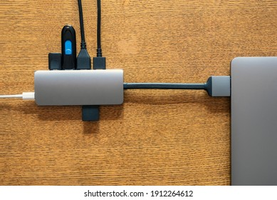 USB hub connected to laptop. Lack of hardware ports on modern laptops concept. Computer technology. Digital background. Internet technology. USB dongle. Transformation of laptop into desktop computer.
