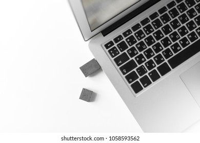 USB memory stick made of concrete on a laptop. Brutal USB flash drive of the cement of hand made