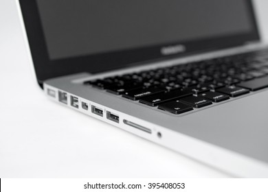 USB port with MacBook Pro on white background