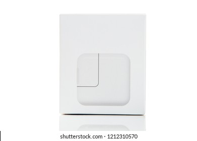 USB power adapter for devices. Charger for devices in box isolated on white background. Front view.