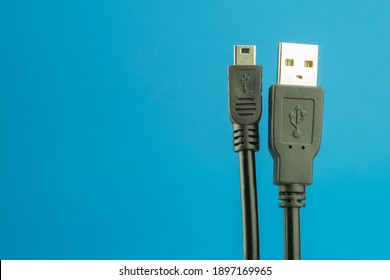 USB Type A cable on a blue background with space for text. USB cable for connecting to digital home appliances. USB (Universal Serial Bus) cable. USB 3.1 5-pin Type C to Mini Type B