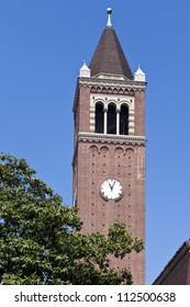 USC clock tower rises above trees on the Los Angeles campus