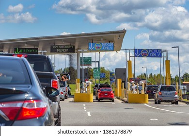 US/Canada Border, Peace Arch, Washington state, USA - September 20, 2018: Busy border crossing between US and Canada.