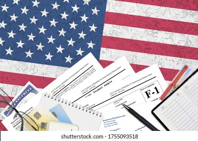 USCIS form I-20 Certificate of eligibility for nonimmigrant student status lies on flat lay office table and ready to fill. U.S. Citizenship and Immigration services paperwork concept - Shutterstock ID 1755093518