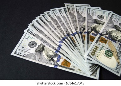 USD 100 dollars, many standing on a black background USD dollars