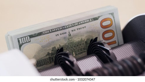 USD banknote on money counting machine