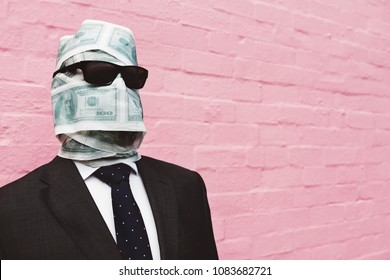 USD printed toilet tissue wrapped around a the head of a business man