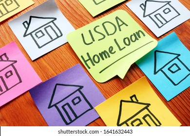 USDA home loan and drawn homes on a paper.