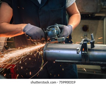 Use of angular grinder in a metalwork factory.