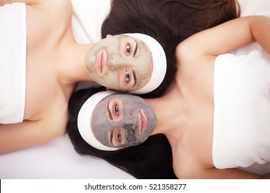 Use of a face mask to the face two young women in a beauty salon