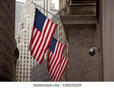 Use flag near an security camera in a facade of Manhattan