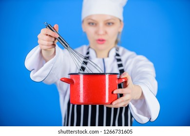 Use hand whisk. Whipping cream tips and tricks. Woman professional chef hold whisk and pot. Start slowly whisking whipping or beating cream. Whipping like pro. Girl in apron whipping eggs or cream.