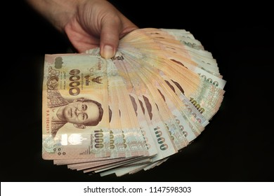 Use hand wipes 1000 Baht of Thailand banknotes with black background