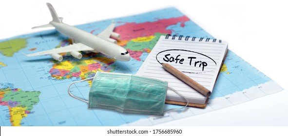 use mask and safe flight check list on note book to go aboard travel with plane after coronavirus pandemic recrase lock down.