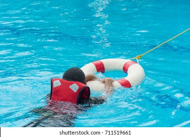 use ring buoy help man drowning in pool