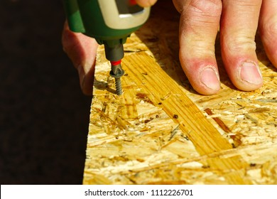 use of a screwdriver for wood screws,Screwing with a screwdriver, clouse-up plane