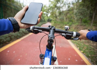 Use smart phone app for navigation while bike ride on the forest trail