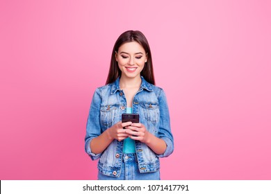 I use smiley faces to express my emotion in sms! Portrait of cute confident lovely attractive charming gorgeous girl watching video on phone, isolated on pink background