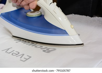 Use steam iron to transfer iron foil onto a T-shirt - close-up
