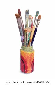 Used artist paintbrushes in a jar.