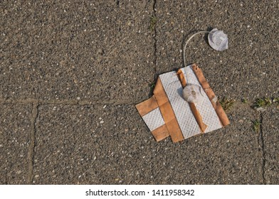 Used band-aid with adhesive electrodes on the ground