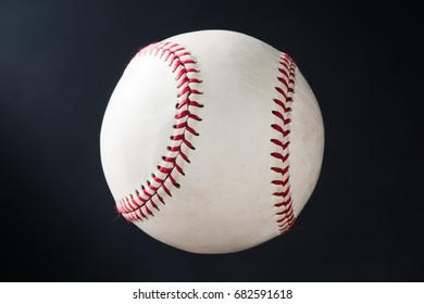 used baseball against dark shade background