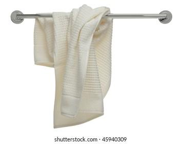 used beige terry cloth towel on a bathroom rail