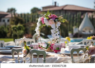 Used in birthday party made in villa garden, table, table ornament chairs and decors.