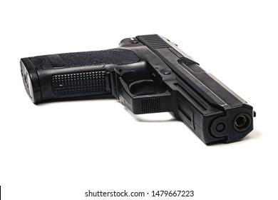 Used black metal 9mm pistol gun on white background