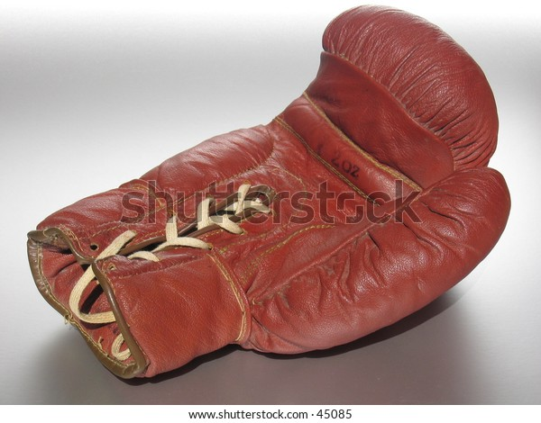 Used boxing glove lying on the backside.