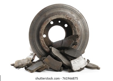 used brake disc and brake pads isolated on white background