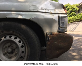 Used car with rusty tire and bumper close up style