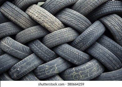used car tires pile in the tire repair shop yard